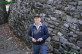 Lawrence Trevanion in front of stone wall by Cheekwood mansion